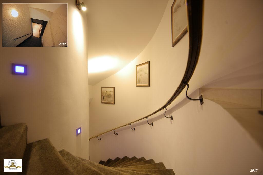 Volledig nieuwe traphal voor toegang tot het tuinverdiep van Hostellerie Kemmelberg ****, inclusief bronzen leuning (uitgevoerd zoals de leuning van de grote trap naar de kamers van de eerste verdieping). Deze trap verving de oude, steile diensttrap.